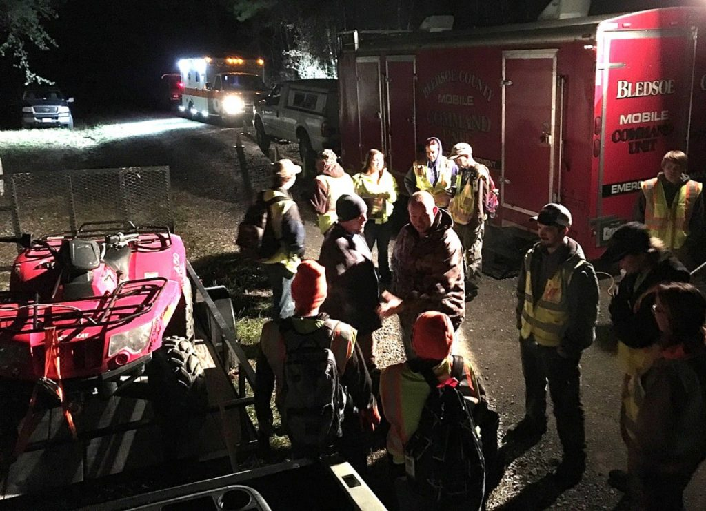 Rescue personnel wait for instruction