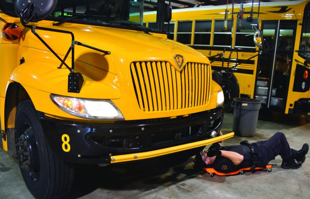 THP Anderson inspects underneath bus