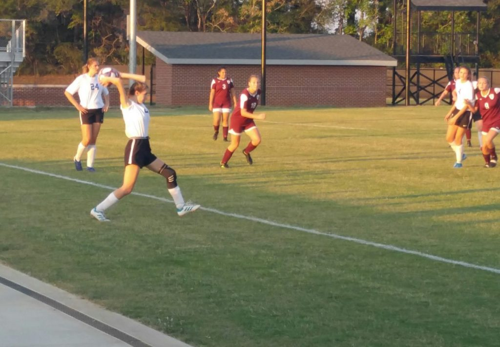 Lady Warrior Gabby Farrell throws ball in during match against White County