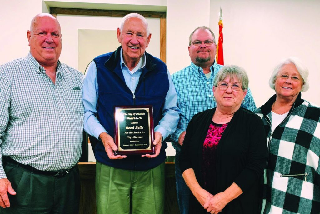 Sells honored for service